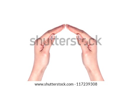 Female hands showing home sign family house concept - stock photo