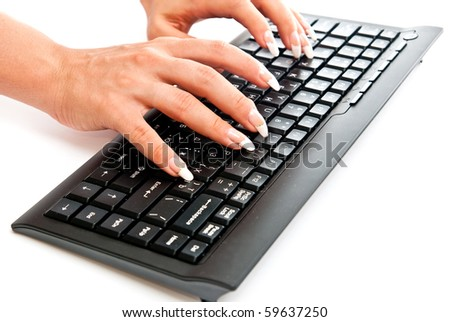 Female hands taping on black pc keyboard. White background