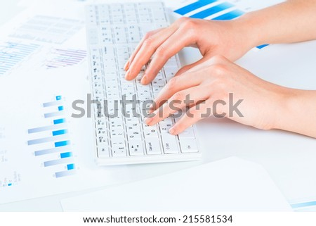 female hands typing on a keyboard text - stock photo