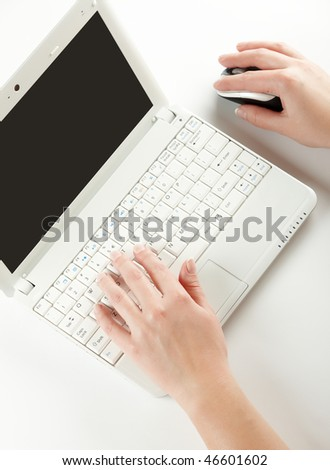 Female hands typing on a laptop keyboard and using mouse