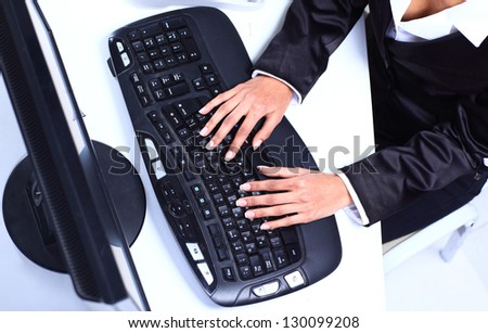 Female hands typing on computer keyboard - stock photo
