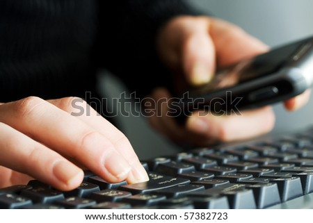 Female hands typing on computer keyboard. - stock photo