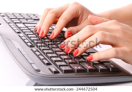 Female hands typing on keyboard - stock photo