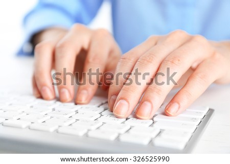 Female hands typing on keyboard close up - stock photo