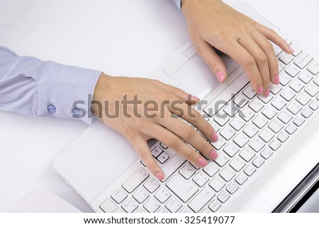 Female hands typing on keyboard,  in a white computer
