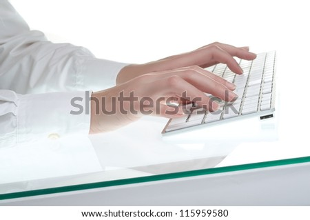 Female hands typing on white computer keyboard - stock photo