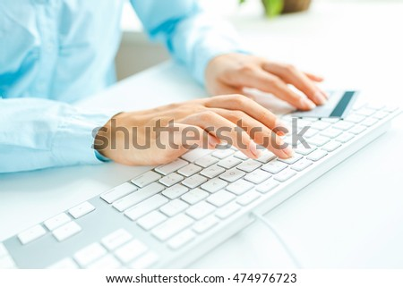 Female hands using computer and credit card on it. Online shopping