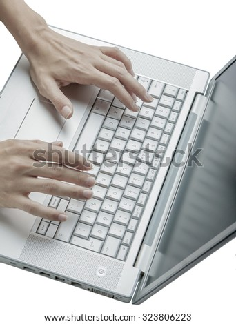 Female hands using keyboard of a laptop