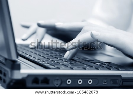 Female hands using laptop
