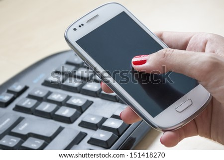 Female hands using Smartphone