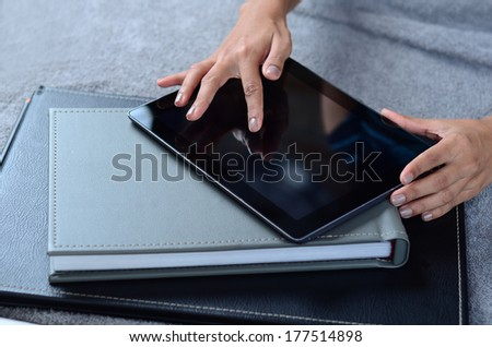 female hands using tablet PC - stock photo