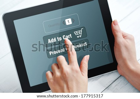 Female hands using touch screen device for online shopping