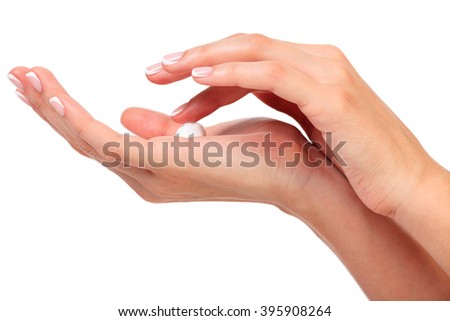 Female hands with a cream, isolated on a white background