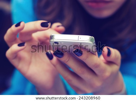 female hands with a mobile phone - stock photo