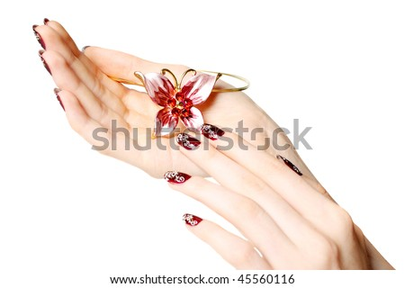 Female hands with beautiful manicure hold costume jewellery - stock photo
