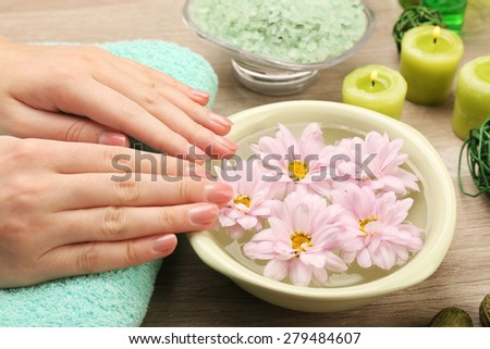 Female hands with bowl of spa water, closeup