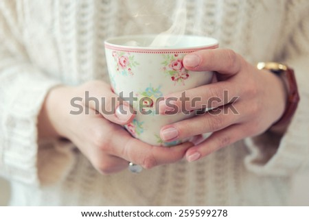 Female hands with coffee