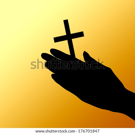 female hands with crucifix over brown background