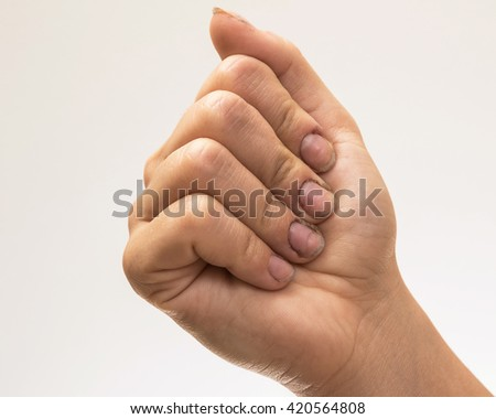 Female hands with dirty nails in studio