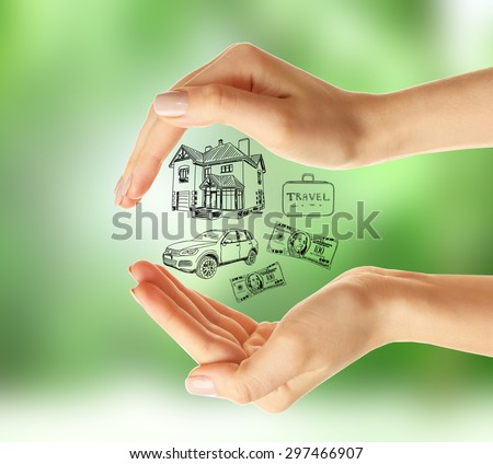 Female hands with drawings on nature background