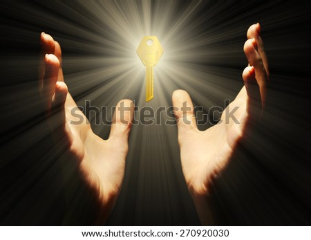 Female hands with key on dark background - stock photo