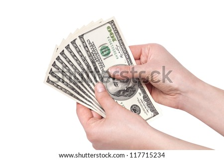 female hands with money isolated on a white background. Dollars - stock photo