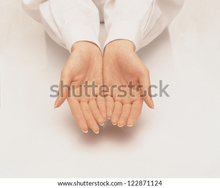 Female hands with palms upwards