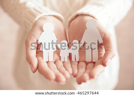 Female hands with paper family. Family love concept