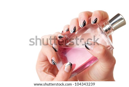 Female hands with parfume battle and  modern  black and white manicure close up isolated on a white background.