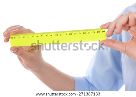 Female hands with plastic ruler isolated on white
