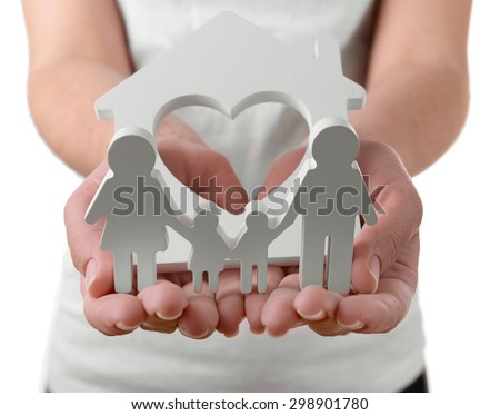 Female hands with small model of house and family isolated on white - stock photo
