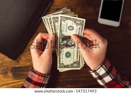 Female hands with US dollar currency cash money, woman counting savings, managing home budget concept