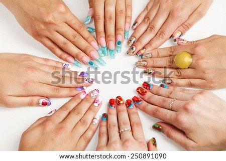 Female hands with various nail arts  - stock photo