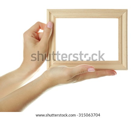 Female hands with wooden frame, isolated on white - stock photo