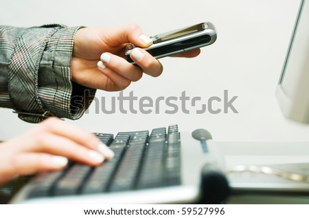 Female hands working on computer. - stock photo