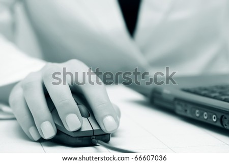 Female hands working on laptop. - stock photo
