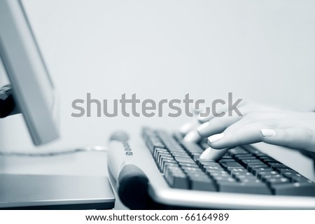 Female hands working on the computer.