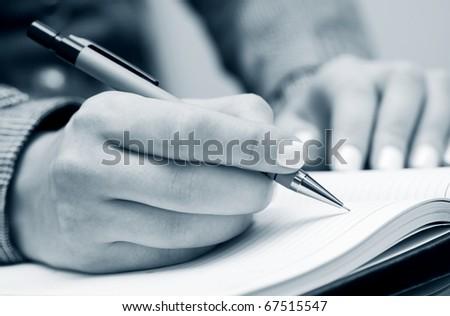 Female hands writing. - stock photo