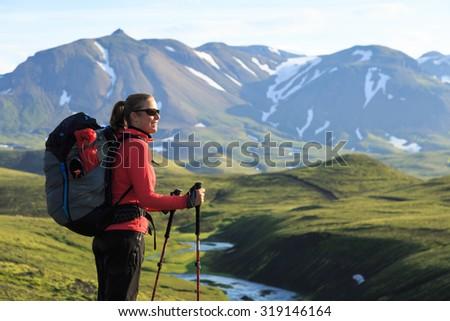 Female hiker enjoying the landscape of the Laugavegur hiking trail on Iceland. - stock photo