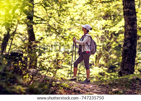 Female hiker on forest trail