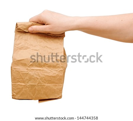 female holding a brown paper bag with contents in his hand - stock photo
