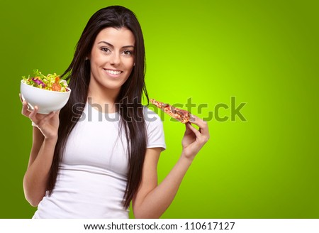 Female Holding A Piece Of Pizza And Salad Bowl On Green Background