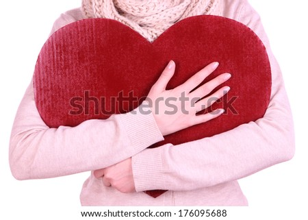 Female holding big red heart isolated on white - stock photo