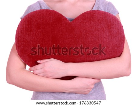 Female holding big red heart isolated on white