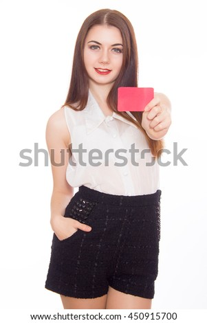 female holding empty credit card, over white background  - stock photo