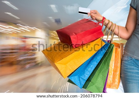 Female holding shopping bags at shopping mall  - stock photo