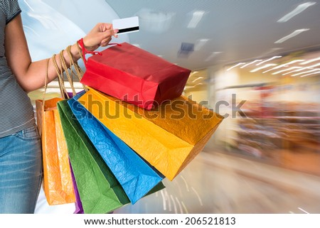Female holding shopping bags at shopping mall