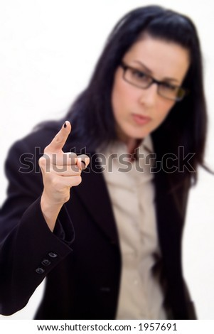 Female holding up finger - stock photo