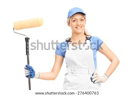 Female house painter in a white uniform posing with a paint roller isolated on white background