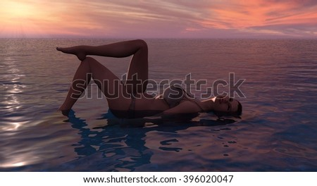 Female In A Bikini Laying In Water At Sunset or Sunrise